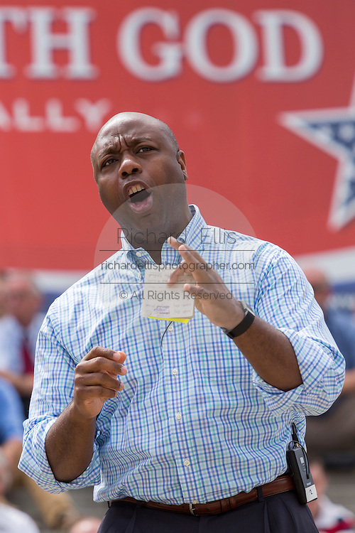 """U.S. Senator Tim Scott (R-SC) addresses a gathering of evangelical Christians during the """"Stand With God"""" rally  August 29, 2015 in Columbia, SC. Thousands of conservative Christians gathered at the State House to rally against gay marriage and listen to GOP presidential candidates Gov. Rick Perry and Sen. Ted Cruz speak."""