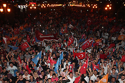 Supporters of Turkey's President and ruling Justice and Development Party, or AKP, leader Recep Tayyip Erdogan celebrate elections victory in Samsun, Sunday, June 24, 2018. Unofficial results from Turkey's presidential election show incumbent Recep Tayyip Erdogan with a commanding lead. (Gokhan Ickilli/DHA/Depo Photos/ABACAPRESS.COM