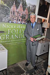 NICKY HASLAM at a party to celebrate the publication of Folly de Grandeur: Romance and Revival in an English Country House by Nicky Haslam held at Oka, 155-167 Fulham Road, London on 21st March 2013.