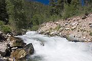 Rio Hondo flows swiftly in summer