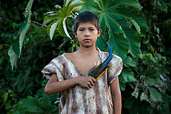 NO WEB/NO APPS - Exclusive. (Text available) Portrait of an Ese-Eja native boy wearing the traditional clothes of his native community 'Palma Real', near Puerto Maldonado, Peru on July 17, 2017. The Amazon rainforest is famous as 'The Lung of the Earth', but also for the presence of numerous native communities, who have always lived isolated and in close contact with nature for generations, used to seek for food and medicines and to build items directly from the environment in which they live. The unstoppable rise of globalization has drastically changed their needs, expectations and consequently their way of life. Located in the Tambopata National Reserve, on the border between Peru and Bolivia, the native Comunidad Palma Real is one of the clearest examples of this change. Living on the banks of the Madre de Dios River since approximately 1976, Palma Real comprises about 300 people part of the nomadic community Ese-Eja, established in the Amazon rainforest of Peru before the Spanish colonization. Photo by Giacomo d'Orlando/ABACAPRESS.COM