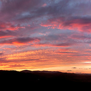 A dramatic sunset over the mountain ridge at Towamba in rural New South Wales, Australia
