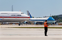 April 17, 2018 - West Palm Beach, Florida, U.S. - The plane carrying Prime Minister Shinzo Abe and his wife  Akie Abe passes by Air Force One as it arrives at Palm Beach International Airport, April 17, in West Palm Beach, Florida. The Prime Minister will meet with President Donald Trump at Mar-a-Lago. (Credit Image: © Greg Lovett/The Palm Beach Post via ZUMA Wire)