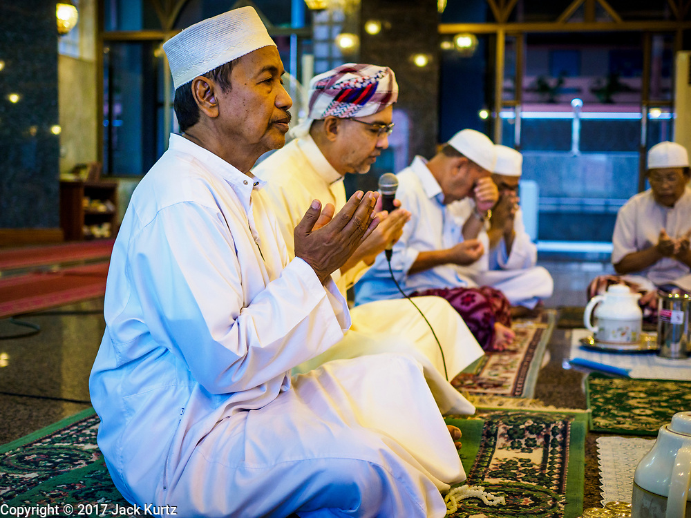 14 JUNE 2017 - BANGKOK, THAILAND: A man prays before Iftar at Masjid Hidayatun Islam. Iftar is the evening meal when Muslims end their daily Ramadan fast at sunset. Iftar is a communal event at Masjid Hidayatun Islam and more than a hundred people usually attend the meal.      PHOTO BY JACK KURTZ