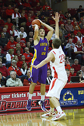 29 December 2011:  Chip Rank takes advantage of some separation between himself and Jon Ekey and fires a long shot during an NCAA mens basketball game between the Northern Illinois Panthers and the Illinois State Redbirds in Redbird Arena, Normal IL