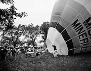 Crowds watch as the Dew Mighty Minerals hot air balloon prepares to launch, as part of the Tullamore Festival Week. The balloon was piloted  by Mr Wilf Woollett, a veterinary surgeon from Loughrea, Co Galway and his co-pilot Kevin Haugh.07/08/1974