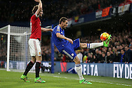 Nemanja Matic of Chelsea does an over head kick past Daley Blind of Manchester United. Barclays Premier league match, Chelsea v Manchester Utd at Stamford Bridge in London on Sunday 7th February 2016.<br /> pic by John Patrick Fletcher, Andrew Orchard sports photography.