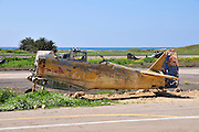 Old disused and dilapedated aeroplane at an airstrip