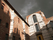 The Facciatone on Piazza del Duomo, and unfinished extension of the Cathedral of Siena. It is now open to the public for excellent views of the whole city, Siena in Tuscany, Italy