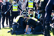 MELBOURNE, VIC - SEPTEMBER 05: Several police officers make two arrests as a commotion breaks out during the Anti-Lockdown Protest on September 05, 2020 in Melbourne, Australia. Stage 4 restrictions are in place from 6pm on Sunday 2 August for metropolitan Melbourne. This includes a curfew from 8pm to 5am every evening. During this time people are only allowed to leave their house for work, and essential health, care or safety reasons. (Photo by Mikko Robles/Speed Media)