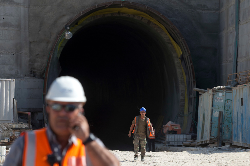 Construction workers are seen at the construction site for tunnel number 2, along the route of the high-speed railway between Tel Aviv and Jerusalem, on november 1, 2011. The new railway, set to be completed in 2017, will span about 55 kilometers and include a series of bridges and tunnels. It will connect Israel's capital to the Greater Tel Aviv Metropolitan Area by means of a high-speed rail link, reducing the travel time between the two cities to approximately half an hour.