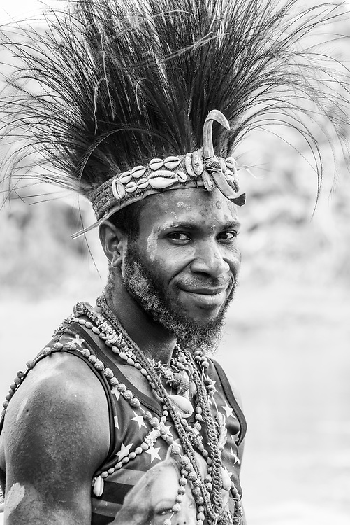 Portrait of Benjamin Endamai, from Yaut village, photographed beside the Keram River in Yar village, East Sepik Province, Papua New Guinea. He was visiting Yar to participate in the dedication of the Waran New Testament.<br /><br />(June 21, 2019)