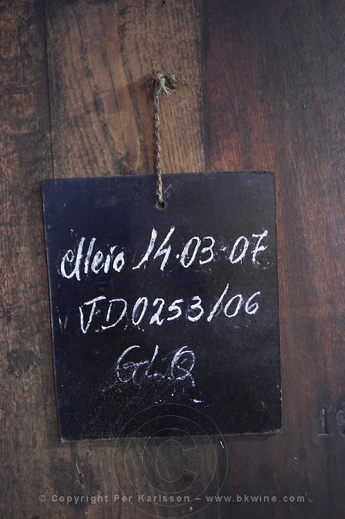 sign on tank chalk board adega cooperativa de borba alentejo portugal