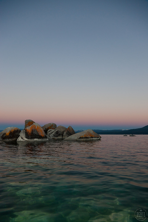 """""""Tahoe Boulders at Sunrise 9"""" - These orange, black, and grey boulders were photographed at sunrise from a kayak near Speedboat Beach, Lake Tahoe."""