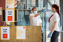 © Licensed to London News Pictures. 24/06/2020. Leeds UK. A member of staff has her temperature taken before starting work this morning as the McDonalds store in Leeds city centre reopened this morning to walk in customers. The food chain is opening 200 high street branches across the UK after being closed to the public due to the Covid 19 outbreak. Photo credit: Andrew McCaren/LNP