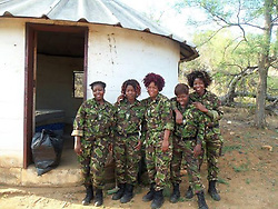 July 7, 2015 - BALULE RESERVE, SOUTH AFRICA: Five female recruits outside their quarters. LED BY BRITISH former military personnel these pictures show how courageous women anti-poachers train with guns in their battle to preserve Africa's endangered animals. Operating in the Kruger National Park's Balule Nature Reserve the 24-member strong all-female Black Mamba Anti-Poaching Unit patrols 50,000 hectares of bush to protect elephants and rhinos that are hunted as part of the estimated £12billion a year illegal world animal trade. These ladies, who as pictures show pose with weapons but also know how to party, are on the front line of a deadly war for the resources of their continent. Over the past year 1,000 wildlife rangers have been killed in Africa while protecting endangered wildlife. Black Mamba Commander and former Royal Navy serviceman Russell Baker (28) from Grimsby, UK explained exclusively how and why this South African special unit was established. (Credit Image: © Media Drum World/MediaDrumWorld/ZUMAPRESS.com)