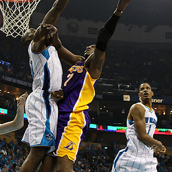 April 28, 2011; New Orleans, LA, USA; Los Angeles Lakers power forward Lamar Odom (7) shoots over New Orleans Hornets center Emeka Okafor (50) during the second quarter in game six of the first round of the 2011 NBA playoffs at the New Orleans Arena.    Mandatory Credit: Derick E. Hingle