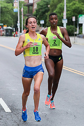 Sarah Pagano of Boston makes a bold and ultimately victorious move by Diane Nukuri of Arizona in the last quarter mile of the all-womens 5K in Albany, New York, a legendary race with a rich racing history now entering it's 5th decade.<br />