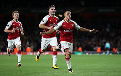 Arsenal's Alexis Sanchez (right) celebrates scoring his side's first goal of the game during the Europa League match at the Emirates Stadium, London.