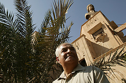 Mowfaq Al-Tai, an Iraqi architect, is seen outside the now partially destroyed Salam Palace in Baghdad, Iraq, Sept. 29, 2003. According to Al-Tai, the Salam Palace is most representative of the design and architecture used in the hundreds of palaces built for Saddam Hussein. Al-Tai was one the the engineers involved in the construction and quality control of the Hussein palaces.