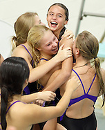 Monroe-Woodbury's divers congratulate Kristin Lubeski during a meet against Middletown in Central Valley on Sept. 24, 2012. Lubeski, a seventh grader in her first year of diving,  scored high enough to qualify for the Section 9 meet.
