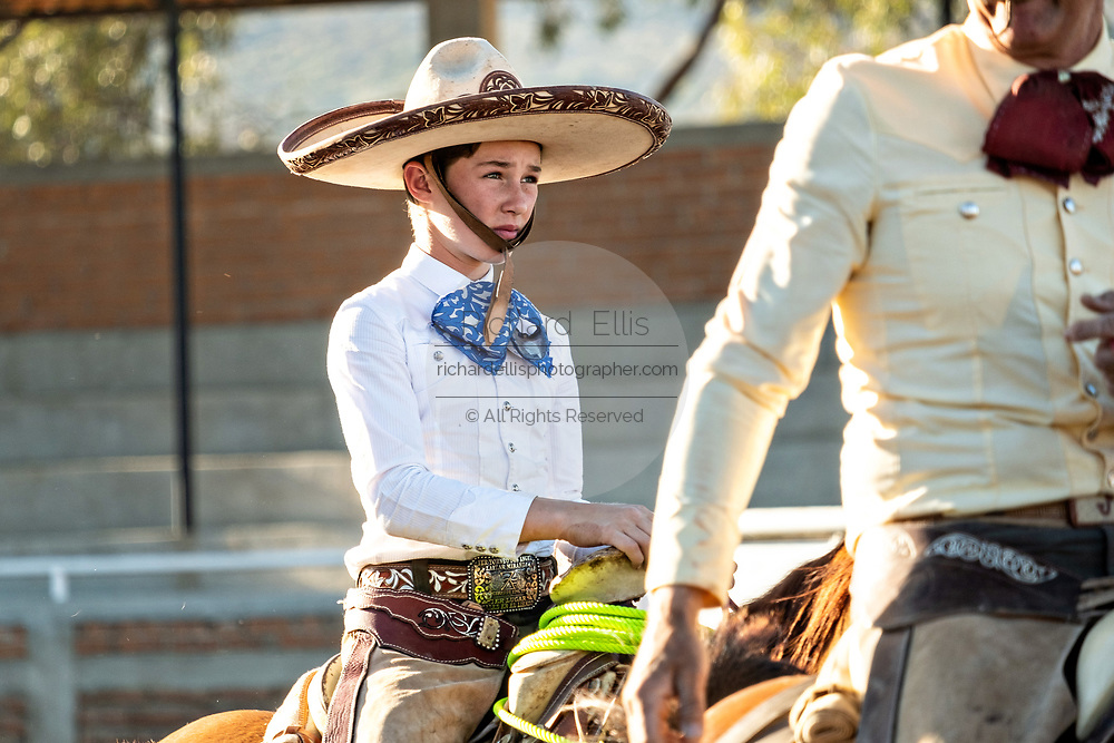 Juan Franco, Jr. on horseback at the family Charreria practice session in the Jalisco Highlands town of Capilla de Guadalupe, Mexico. The Franco family has dominated Mexican rodeo for 40-years and has won three national championships, five second places and five third places.