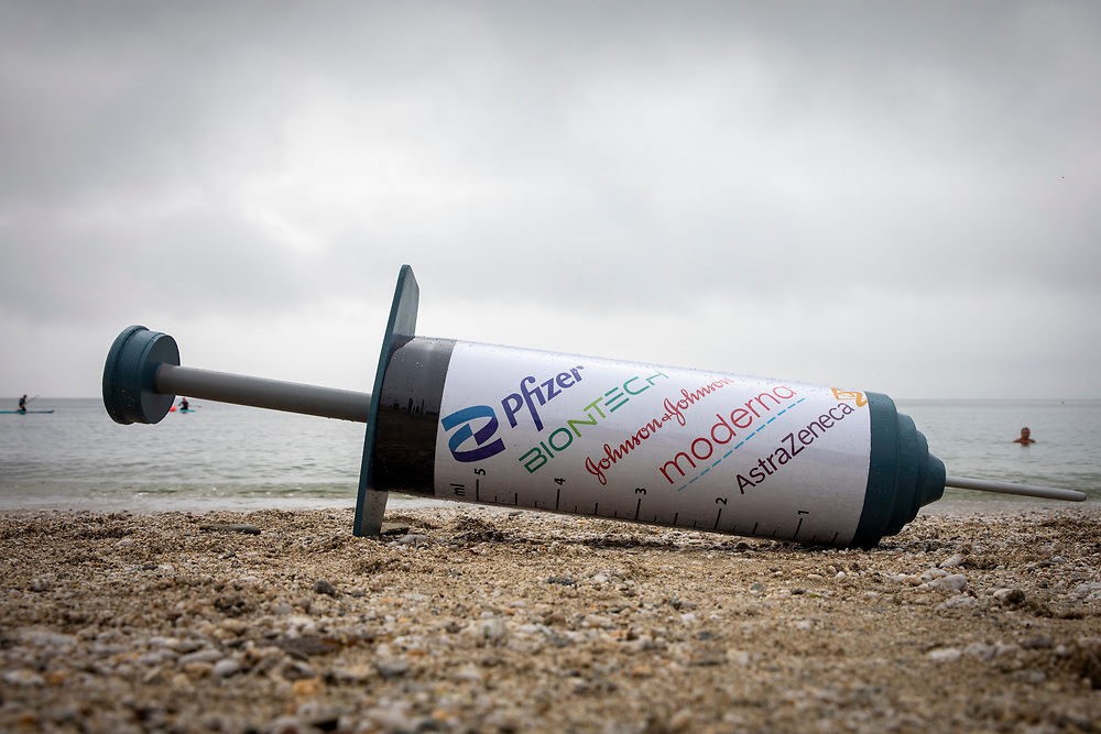 A giant COVID-19 vaccine syringe used for a campaign by The People's Vaccine Alliance on the 11th of June 2021 near Falmouth, Cornwall, United Kingdom.(photo by Andrew Aitchison/In Pictures via Getty Images)
