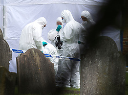 © London News Pictures. 10/07/2012. Writtle, UK. Forensics at the scene where the body of 64 year-old Peter Reeve was found in the graveyard at All Saints CHurch in Writtle, Essex on July 10, 2012. Peter Reeve was being hunted by police in connection with the murder of Pc Ian Dibell in Clacton.  Photo credit: Ben Cawthra/LNP.