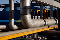 Stock photo of pipes running outside of a chemical plant