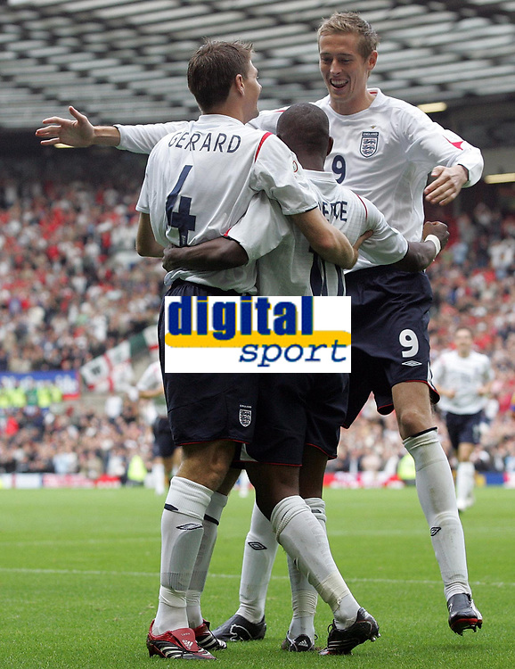 Photo: Paul Thomas.<br /> England v Andorra. European Championships 2008 Qualifying. 02/09/2006.<br /> <br /> Jermaine Defoe celebrates his goal for England with Steven Gerrard (L) and Peter Crouch (R).