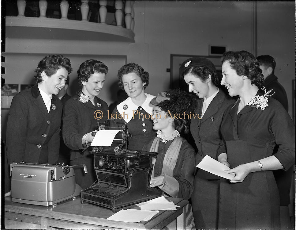 19/03/1958<br /> 03/19/1958<br /> 19 March 1958<br /> Remington reception, Office Efficiency exhibition at Royal Hibernian Hotel. Hostess in 'period ' costume demonstrates antique typewriter.
