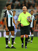 NEWCASTLE UPON TYNE, ENGLAND - SEPTEMBER 17: Joelinton of Newcastle United and the referee, Mike Dean, during the Premier League match between Newcastle United and Leeds United at St. James Park on September 17, 2021 in Newcastle upon Tyne, England. (Photo by MB Media)
