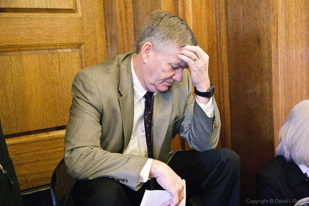 Alaska Senator Charlie Huggins (R) waits for a Finance Committee hearing to begin in the Alaska State Legislature building.