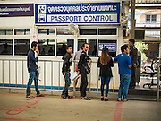 25 OCTOBER 2016 - MAE SOT, TAK, THAILAND:  People entering Thailand through the Thai customs and immigration post in Mae Sot on the Thai side of the border with Myanmar line up at Passport Control. The Thai-Myanmar border between Mae Sot and Myawaddy has become an important commercial crossing as democratic reforms in Myanmar (Burma) has created new economic opportunities in Thailand.   PHOTO BY JACK KURTZ