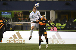 October 8, 2018 - Seattle, Washington, U.S - Seattle's CHAD MARSHALL (14) heads the ball as Houston's ARTURO ALVAREZ (12) challenges on the play. The Houston Dynamo visited the Seattle Sounders in a MLS match at Century Link Field in Seattle, WA. Seattle won the match 4-1. (Credit Image: © Jeff Halstead/ZUMA Wire)