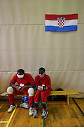 Zwei serbische Spieler warten beim internationalen Goalball Turnier in Zagreb auf ihren Einsatz. Goalball ist eine Mannschaftssportart für blinde und sehbehinderte Menschen und wurde vom Österreicher Hans Lorenzen und dem deutschen Sepp Reindle für Kriegsinvalide entwickelt und zum ersten Mal 1946 gespielt. Die Bilder entstanden auf zwei internationalen Goalball Turnieren in Budapest und Zagreb 2007.<br /> <br /> Two serbian players are waiting for their run-out during the international Goalball tournament in Zagreb. Goalball is a team sport designed for blind and visually impaired athletes. It was devised by an Austrian, Hanz Lorenzen, and a German, Sepp Reindle, in 1946 in an effort to help in the rehabilitation of visually impaired World War II veterans. The International Blind Sports Federatgion (IBSA - www.ibsa.es), responsible for fifteen sports for the blind and partially sighted in total, is the governing body for this sport. The images were made during two Goalball tournaments in Budapest and Zahreb 2007.