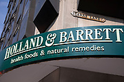 Sign for the health shop brand Holland & Barrett in Birmingham, United Kingdom.
