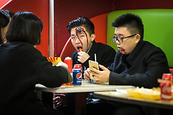 © Licensed to London News Pictures . 31/10/2015 . Manchester , UK . People eating in a fast food restaurant on Withy Grove . Halloween revellers , wearing make up and costumes , out and about in Manchester City Centre . Photo credit : Joel Goodman/LNP