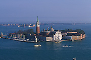 San Giorgio Maggiore basilica faces St. Mark's canal. The church was designed by Andrea Palladio and is located on the island of San Giorgio Maggiore. Viewed from Campanile tower, Venice, Italy..Subject photograph(s) are copyright Edward McCain. All rights are reserved except those specifically granted by Edward McCain in writing prior to publication...McCain Photography.211 S 4th Avenue.Tucson, AZ 85701-2103.(520) 623-1998.mobile: (520) 990-0999.fax: (520) 623-1190.http://www.mccainphoto.com.edward@mccainphoto.com.