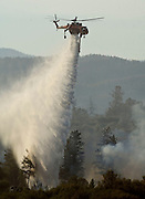 Greeley Hill, California-- July 31, 2008-Telegraph Fire-Wildfires Threaten Yosemite National Park. Sky Crane puts water on hot spot in division M..Photo by Al GOLUB/Golub Photography