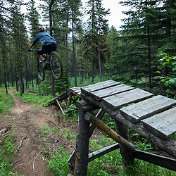 Pete Hoang getting air on Race of Spades at Moose Mountain in Alberta, Canada