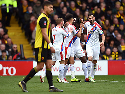 Crystal Palace's Michy Batshuayi (centre) celebrates scoring his sides first goal of the game with Andros Townsend (left) and Luka Milivojevic