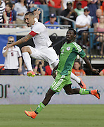 JACKSONVILLE, FL - JUNE 07:  Forward Clint Dempsey #8 of the United States follows through after taking a shot in front of defender Juwon Oshaniwa #13 of Nigeria during the international friendly match at EverBank Field on June 7, 2014 in Jacksonville, Florida.  (Photo by Mike Zarrilli/Getty Images)