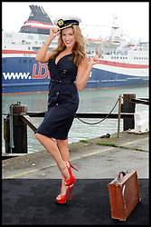 Model Kelly Brook today launched the inaugural sailing of a new ferry route between Dover to Calais run by DFDS Seaways and LD Lines. Dressed in a sailor's outfit, Kelly was joined by Carsten Jensen, senior vice-president, DFDS Seaways and Christophe Santoni, managing director, LD Lines to cut the ribbon, cementing the opening of the new route...Champagne corks were popped dockside before the Norman Spirit set sail.  Accompanying the vessel as it departed was a Port of Dover tug, firing its water cannon and sounding its horn. The new route will operate up to five times a day, with the first sailings aboard the Norman Spirit. A second ship and additional sailings will be added to the schedule at a later date. Friday February 17, 2012. Photo By i-Images
