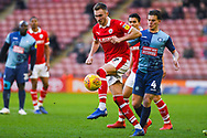 Ryan Hedges of Barnsley (7) in action under pressure from Dominic Gape of Wycombe Wanderers (4) during the EFL Sky Bet League 1 match between Barnsley and Wycombe Wanderers at Oakwell, Barnsley, England on 16 February 2019.