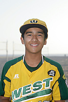 26 September 2011: #15 Christian Catano 2011 Little League Baseball World Series Championship team portrait northside of the Huntington Beach Pier at sunset in Southern California.  Ocean View team WEST beat Hamamtsu City, Japan, 2-1, to become the seventh team from California to win the title on August 28, 2011 in South Williamsport, PA.