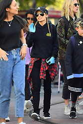 EXCLUSIVE: Nicole Richie and her husband Joel Madden try to keep the germs away while at Disneyland by wearing a surgical mask and plastic gloves. Nicole was seen wearing blue rubber gloves to avoid getting any germs on her hand and her husband Joel was seen wearing a surgical mask to avoid getting sick as well. Today was a very busy day at the happiest place on earth, so these weren't bad choices. Despite worrying about getting sick, the couple had a great time riding many of the park's rides including the Car's Radiator Springs Racers and the incredicoaster. 16 Feb 2020 Pictured: Nicole Richie and Joel Madden. Photo credit: Marksman / MEGA TheMegaAgency.com +1 888 505 6342