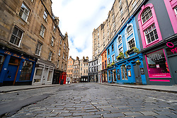 View of empty Victoria Street in Edinburgh Old Town during Covid-19 pandemic lockdown, Scotland, UK