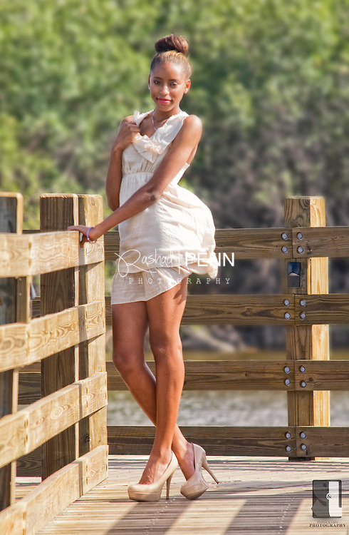 Ashley Russell on the Cable Beach strip on the board walk. Outdoor Portrait Photo Shoot