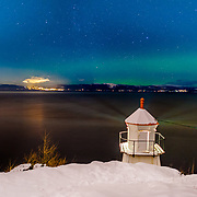 I took this photo in december while I was trying to shoot the stars I saw a faint northern light over the horizon. Lucky enough I could capture the light from light house as well. The lighthouse itself was spreding a nice light pattern over the Tronheimfjorden, ladekaia, vinter, winter, trondheimwinter, vinteren